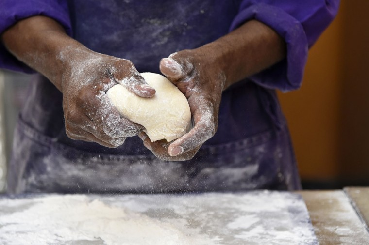 "James Hamlin, owner of The Avenue Bakery, kneads dough for his famous ""Poppay's"" dinner rolls. (Barbara Haddock Taylor/Baltimore Sun)"