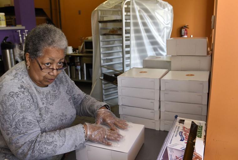 Brenda Hamlin, wife of owner James Hamlin, talks to a customer at the pick up window of The Avenue Bakery. (Barbara Haddock Taylor/Baltimore Sun)