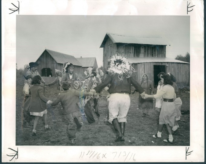 Lumbee Indians hold a powwow on their Southern Maryland farm. The man beating the tom-tom is Philip S. Proctor, a Piscataway Indian of this state who persuaded the others to migrate up from North Carolina. Mr. Proctor, whose Indian name is Turkey Tayac, has been encouraging the Lumbees to revive long-forgotten ceremonies. (A. Aubrey Bodine/Baltimore Sun) Though many Lumbee migrated to Baltimore, in May 1950, The Sun also wrote about a group that came to St. Mary's County in Maryland. A. Aubrey photographed two families that had been tenant farmers in North Carolina but were able to purchase land in Maryland. A Maryland Piscataway Indian named Philip S. Proctor had been encouraging Lumbee to craft Indian costumes and to revive old cultural practices like powwows.