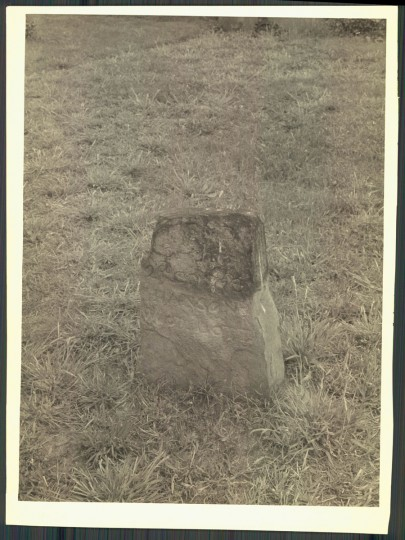 """This stone is incised """"Hanson's Wood Lott"""" and is believed to be an old city boundary marker. Photo from 1957. (A. Aubrey Bodine/Baltimore Sun)"""