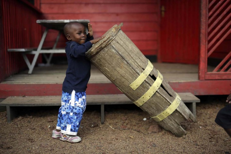 In this photo taken on Sunday, June 19, 2016, five-year-old Alpha Meleki plays in the yard at the En Avant Les Enfants INUKA center in Goma, Democratic Republic of Congo. Melee survived an attack from ADF rebels on his village that left over 20 dead including his parents in Beni in January 2016. Rescuers found Meleki in a pile of bodies with a bullet wound to his belly. (AP Photo/Jerome Delay)