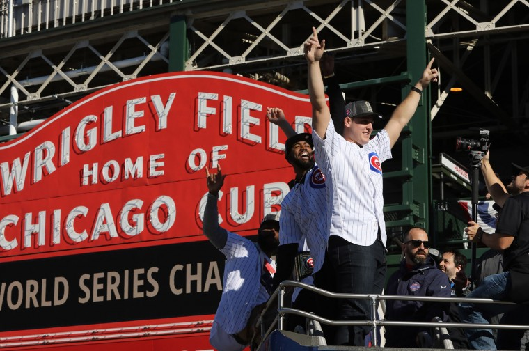 Chicago Cubs Anthony Rizzo along with teammates family, staff and friends roll pass in a double decker bus past the iconic Wrigley Field Chicago Cubs marque during the parade honoring the World Series Champion Chicago Cubs, Friday, Nov. 4, 2016. (Antonio Perez/Chicago Tribune/TNS)