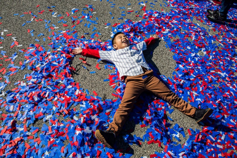 Rudy Toees, 5, celebrates the World Series champion Chicago Cubs during a parade and rally in Grant Park in Chicago on Friday, Nov. 4, 2016. (Zbigniew Bzdak/Chicago Tribune/TNS)