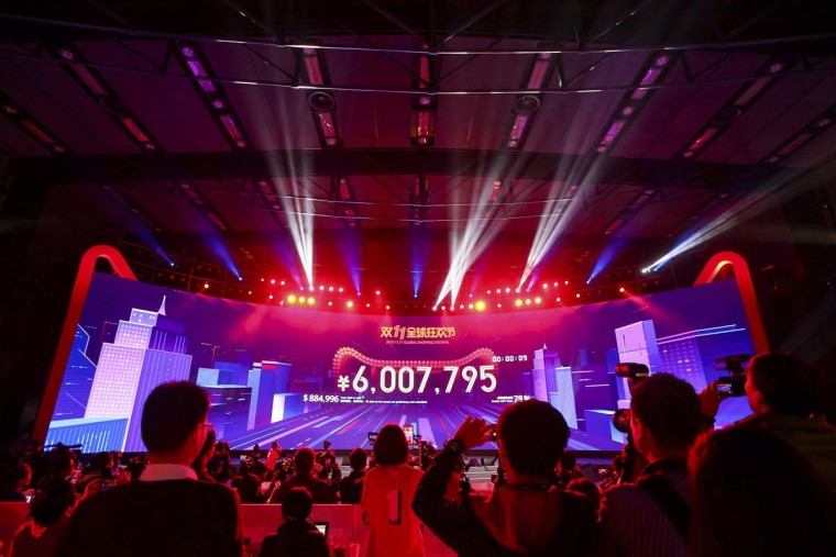"Attendees watch the start of the Singles Day online shopping festival just past midnight with a screen showing the transaction volume in Shenzhen in southern China's Guangdong province Friday, Nov. 11, 2016. China's online shoppers are engaging in a rare bright spot for its cooling economy - a quirky holiday dubbed ""Singles Day"" that has grown into the world's busiest day for e-commerce. The country's biggest e-commerce brand, Alibaba Group, said Friday sales by the thousands of retailers on its platforms passed 62.6 billion yuan ($9 billion) in the first 10 hours of the day. (Chinatopix Via AP)"