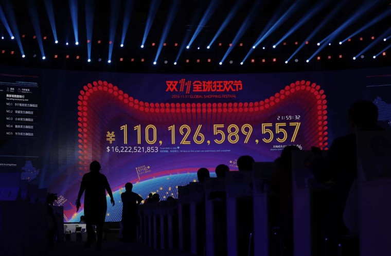 "A giant screen showing a total sales transacted of e-commerce giant Alibaba, on the ""Singles' Day"" global online shopping festival in Shenzhen, southern China's Guangdong province Friday, Nov. 11, 2016. In a bright spot for China's cooling economy, online shoppers spent billions of dollars Friday on ""Singles' Day,"" a quirky holiday that has grown into the world's busiest day for e-commerce. (AP Photo/Kin Cheung)"