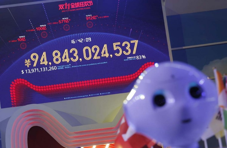 "A screen showing a total sales transacted of e-commerce giant Alibaba on the ""Singles' Day"" global online shopping festival in Shenzhen, southern China's Guangdong province, Friday, Nov. 11, 2016. In a bright spot for China's cooling economy, online shoppers spent billions of dollars Friday on ""Singles Day,"" a quirky holiday that has grown into the world's busiest day for e-commerce. (AP Photo/Kin Cheung)"