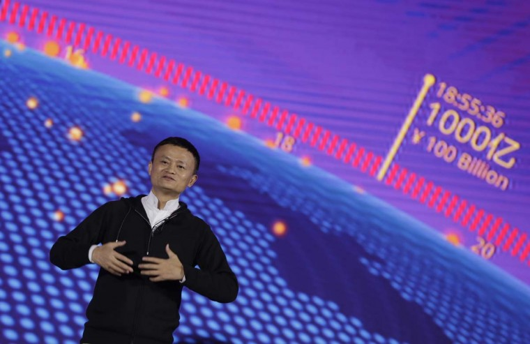 "Alibaba Group Chairman Jack Ma speaks on ""Singles Day"" global online shopping festival in Shenzhen, southern China's Guangdong province Friday, Nov. 11, 2016. In a bright spot for China's cooling economy, online shoppers spent billions of dollars Friday on ""Singles Day,"" a quirky holiday that has grown into the world's busiest day for e-commerce. (AP Photo/Kin Cheung)"