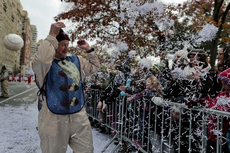 Spectators shower a ballon operator with shredded paper during the Macy's Thanksgiving Day parade, Thursday, Nov. 24, 2016, in New York. (AP Photo/Julie Jacobson)