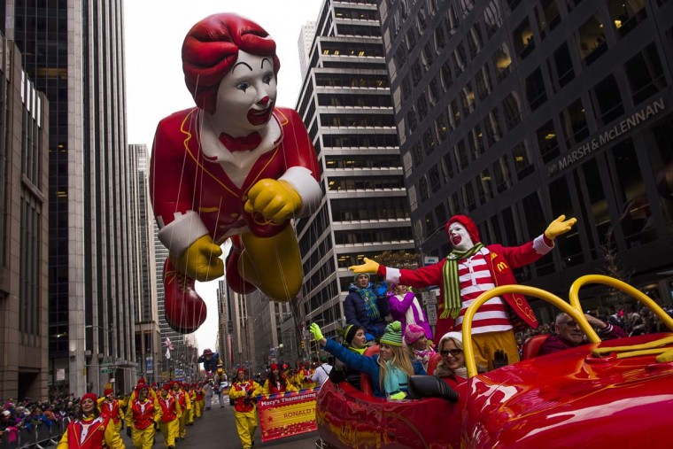 Ronald McDonald and a Ronald McDonald balloon make their way across Sixth Avenue during the Macy's Thanksgiving Day Parade, in New York, Thursday, Nov. 24, 2016. (AP Photo/Andres Kudacki)