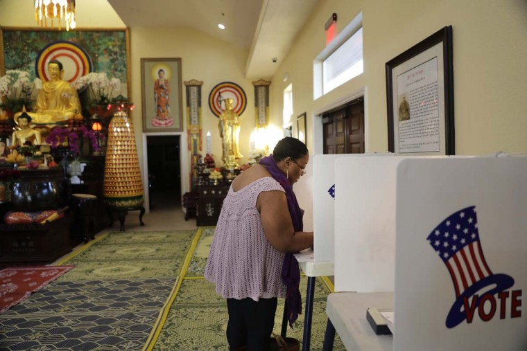 Denise Richardson casts her vote at Chua Phat To Gotama Temple on Tuesday, Nov. 8, 2016, in Long Beach, Calif. (AP Photo/Jae C. Hong)