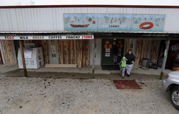 Jennifer Swaggerty and her son Justin, 4, from Stockton, Mo, leave the Caplinger Mills Trading Post after voting Tuesday, Nov. 8, 2016, in Caplinger Mills, Mo. (AP Photo/Charlie Riedel)