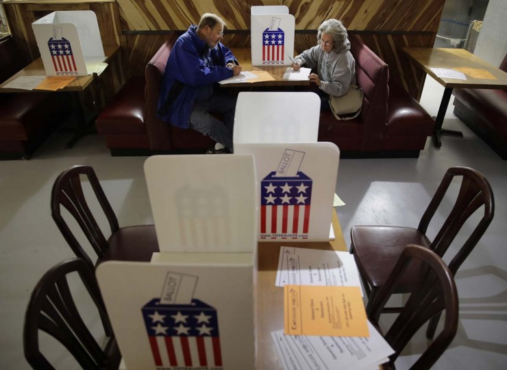John and Colleen Kramer, of Stockton, Mo., vote at the Caplinger Mills Trading Post on Tuesday, Nov. 8, 2016, in Caplinger Mills, Mo. (AP Photo/Charlie Riedel)