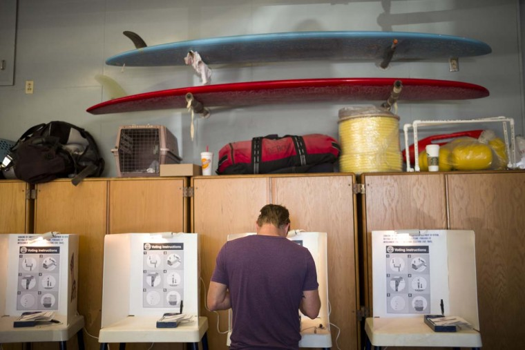 Billy Tolson casts his vote at the Venice Beach lifeguard headquarters Tuesday, Nov. 8, 2016, in Los Angeles. (AP Photo/Jae C. Hong)