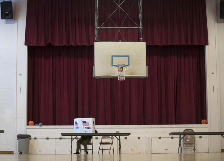 A voter fills out a ballot in the gymnasium at the St. Mary's Academy building on Tuesday, Nov. 8, 2016, in Hudson, N.Y. (AP Photo/Mike Groll)