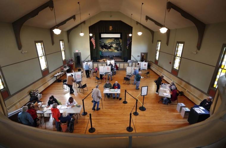 Voters cast their ballots at historic Holley Hall, Tuesday, Nov. 8, 2016, in Bristol, Vt. (AP Photo/Robert F. Bukaty)