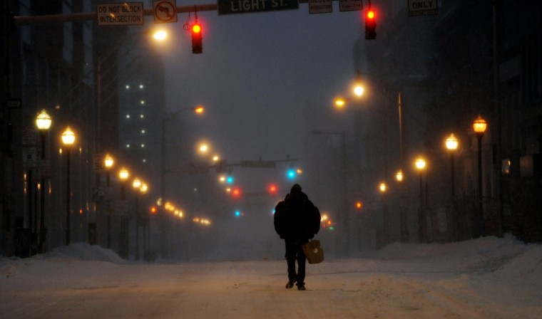 Edward Nelson, a homeless man, walks on Baltimore Street searching for somewhere to keep warm on Saturday, Jan. 23, 2016, during a powerful weekend storm blanketing the East Coast in snow. (Kim Hairston/Baltimore Sun)