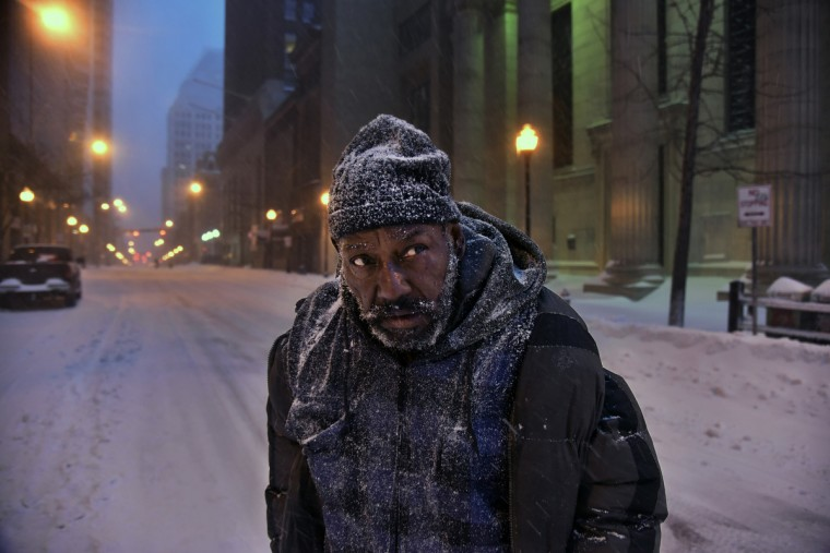 Edward Nelson walks on Baltimore Street during the blizzard Saturday morning. Nelson, who is homeless, is searching for somewhere to keep warm. Says he'll probably go to Lexington Market.  (Kim Hairston/Baltimore Sun)