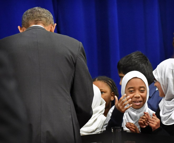 Yasmeen R'Ghioui, 9, a fourth grader at Al-Rahmah School, reacts to her friend after shaking hand with President Barack Obama, left, during his visit to the Islamic Society of Baltimore, one of the largest mosques in the region. The President is making his presidency's first visit to a U.S. mosque.  (Kenneth K. Lam/Baltimore Sun)