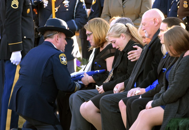 Jennifer Logsdon is given the flag from her late husband Senior Deputy Mark Logsdon's casket. Harford County Sheriff's Senior Deputy Mark Logsdon is laid to rest at Dulaney Valley memorial Gardens.Logsdon and Senior Deputy Patrick Dailey were killed February 10th in the line of duty before deputies killed David Evans, the gunman.  (Algerina Perna/Baltimore Sun)