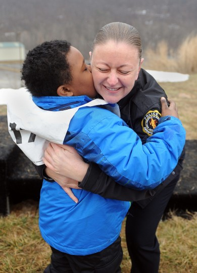"Detective Deborah Sauriol-Inoni of the Annapolis police department (a volunteer) gets a hug from Anthony ""Stormy"" Zanfordino of Charles County, just after receiving his gold medal in a snowshoe event at the winter 2016 Special Olympics, which was held at Whitetail Ski Resort.  (Barbara Haddock Taylor/Baltimore Sun)"