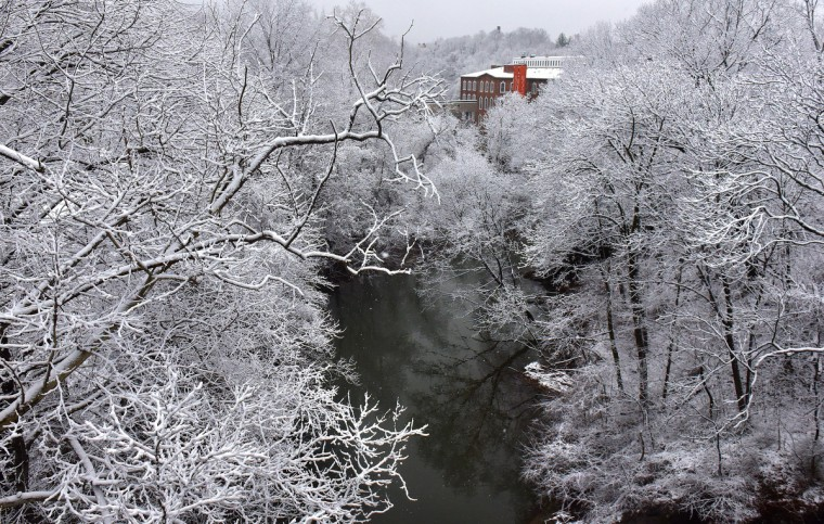 The Mill No. 1 building on the Jones Falls provides a spot of color in a black-and-white landscape after last night's light snow. (Jerry Jackson/Baltimore Sun)