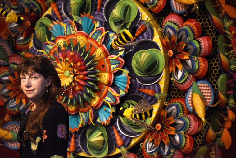 "Wendy Brackman created a mandala made of painted paper plates for ""Yummm! The History, Fantasy and Future of Food,"" a new exhibit at the American Visionary Art Museum.  (Kim Hairston/Baltimore Sun)"