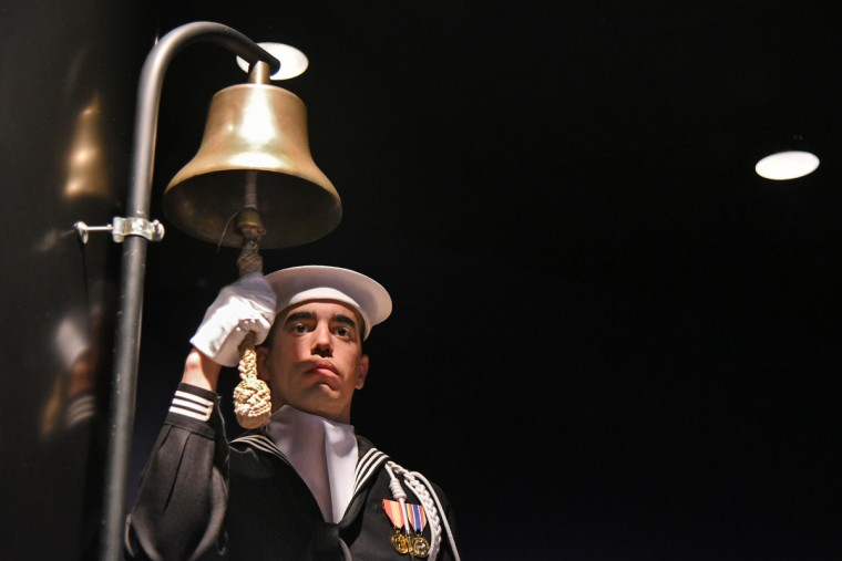 Seaman Michael Santiago, a ceremonial guard, rings the bell 56 times in memory of the officers and crew who disappeared on the USS Conestoga in the Pacific in 1921. The ceremony was part of a press conference held by NOAA and the U.S. Navy at the Naval Heritage Center to announce the discovery of the USS Conestoga, 95 years after it disappeared. Descendants of the crewmembers were in attendance. The Baltimore-built tugboat  was found in the Greater Farallones National Marine Sanctuary off San Francisco, solving one of the top maritime mysteries in U.S. Naval history. (Amy Davis/Baltimore Sun)