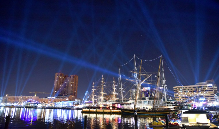 Synchronized spotlights ring Baltimore's Inner Harbor during Light City Baltimore.  (Jerry Jackson/Baltimore Sun)