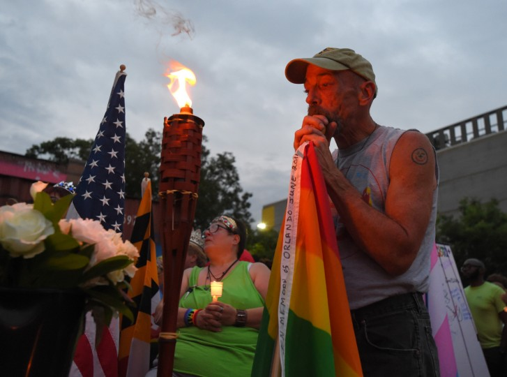 Rick Newton-Treadway of Baltimore during the vigil in honor of the Orlando shooting victims held here in Baltimore at Y-Not Lot off of W. North Ave.    (Lloyd Fox/Baltimore Sun)
