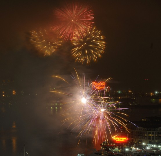 Fireworkslight up the sky during 4th of July festivities at Baltimore's Inner Harbor.  (Jerry Jackson/Baltimore Sun)