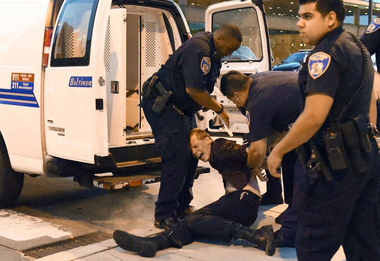 A protestor is arrested at Pratt and Charles after he refused to keep moving down the street while protesting the police shooting deaths in Baton Rouge and Minneapolis this week. (Jerry Jackson/Baltimore Sun)