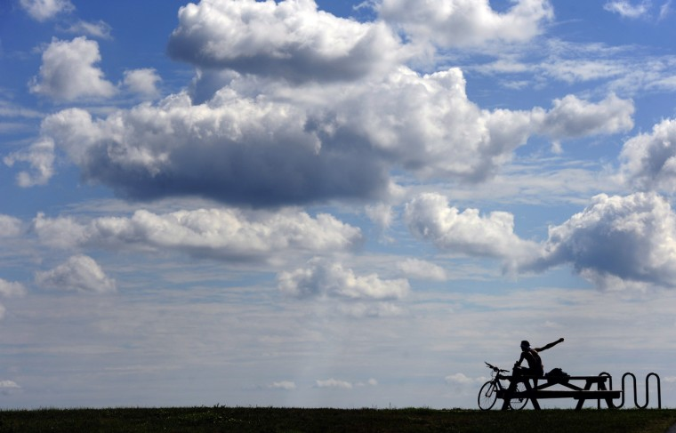 A cyclist enjoys the view from a section of the BWI Trail that overlooks BWI Thurgood Marshall Airport.  (Kim Hairston/Baltimore Sun)