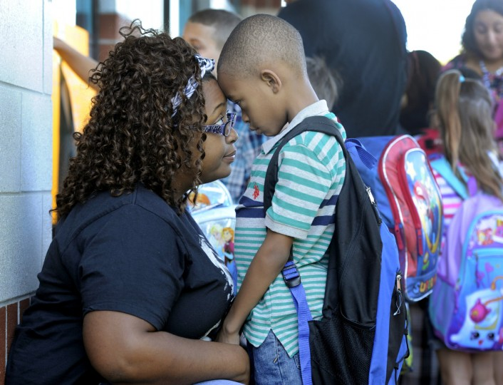 Zatia Vaughan, Brooklyn Park, speaks with her son, Zyon Gibson, 7, first grade, outside Park Elementary School on opening day for Anne Arundel County Public Schools. (Kim Hairston/Baltimore Sun)