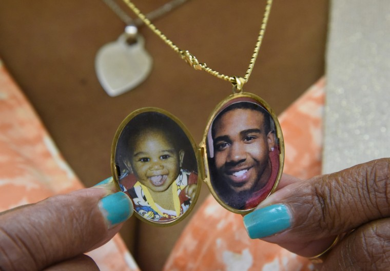 Cynthia Bruce of Manchester, who lost her son Marcus Downer in 2015, at the monthly community meeting for Mothers of Murdered Sons and Daughters United (MOMS), held at St. John's Alpha and Omega Church. She is holding a locket with his photos.  (Amy Davis/Baltimore Sun)