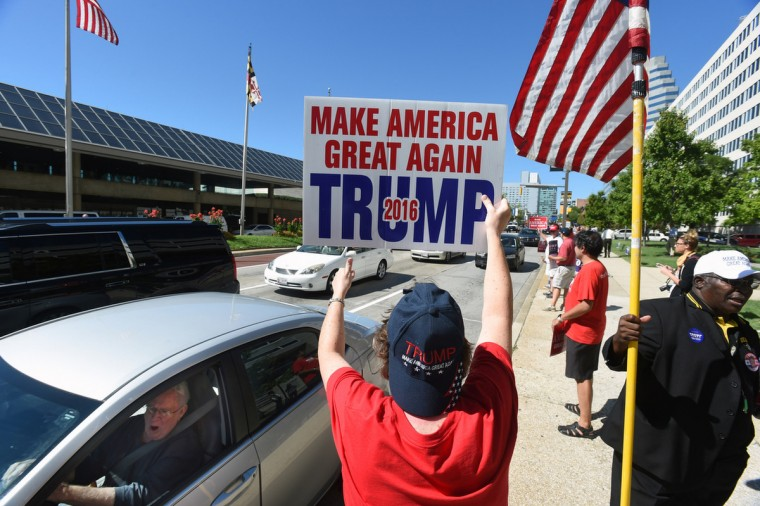 Patty Fallon, center, of Baltimore, a Donald Trump supporter rally for Trump across the street from the Baltimore Convention Center where Trump addressed a gathering at the National Guards convention. (Kenneth K. Lam/Baltimore Sun)