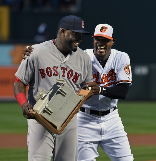 The Orioles Adam Jones, right, presents the broken dugout phone to Red Sox's David Ortiz, left, during pregame special retirement ceremony at Oriole Park at Camden Yards. (Kenneth K. Lam/Baltimore Sun)