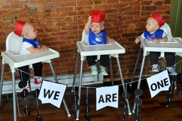Identical triplets Trip, Finn and Ollie Hewitt wear red paper crowns as they await their first taste of birthday cake at the party to celebrate becoming one-year olds. Thomas and Kristen Hewitt of Hampden celebrated the first birthday for their triplets with family and friends at Cafe Hon. The identical triplets turned one on Oct. 6.  (Amy Davis/Baltimore Sun)