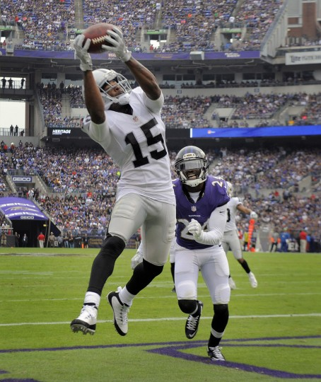 The Raiders' Michael Crabtree (#15), left, catches a touchdown pass in front of Ravens' Shareece Wright, right, in the second quarter. The Raiders defeated the Ravens by score of 28 to 27 at M & T Bank Stadium. (Kenneth K. Lam/Baltimore Sun)