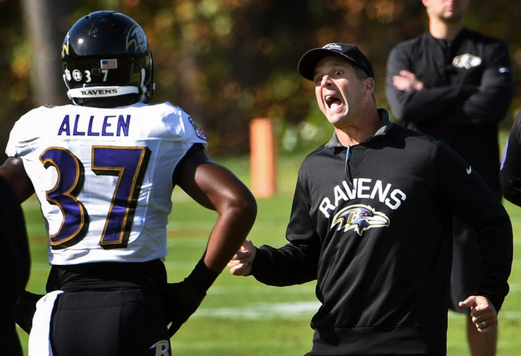 Ravens head coach John Harbaugh, right, emphasizes a point with running back Buck Allen during practice at Under Armour Performance Center. (Kenneth K. Lam/Baltimore Sun)
