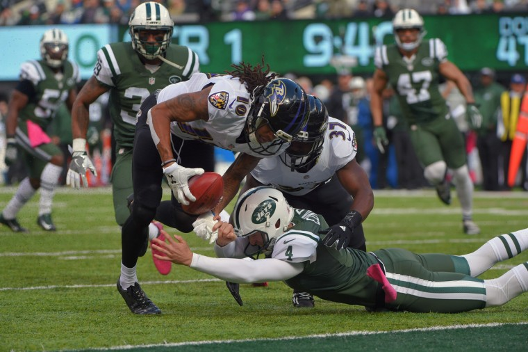 Baltimore Ravens' Javorius Allen (37) blocks New York Jets punter Lac Edwards (4) as Chris Moore (10) follows the muffed punt into the end zone for a touchdown during the first quarter.  (Karl Merton Ferron / Baltimore Sun)
