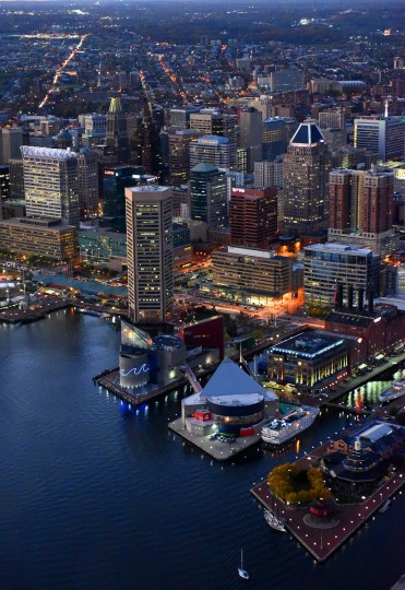 Seen from above, Baltimore's skyline glows at twilight. (Jerry Jackson/Batitmore Sun)