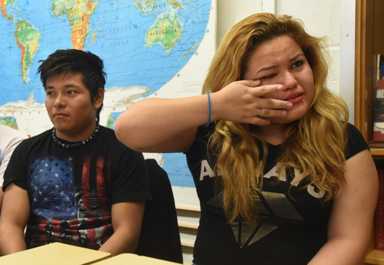 Joseline Orellana, 16, right, an 11th grader at Patterson High School, wipes away tears after getting upset while talking about the outcome of the presidential election. At left is Wilmer Cruz, 18, a 12th grader from Guatemala. The staff who work with the immigrant students in the English as a Second Language program are counseling students who express unease about the election of Donald Trump.  (Amy Davis/Baltimore Sun)