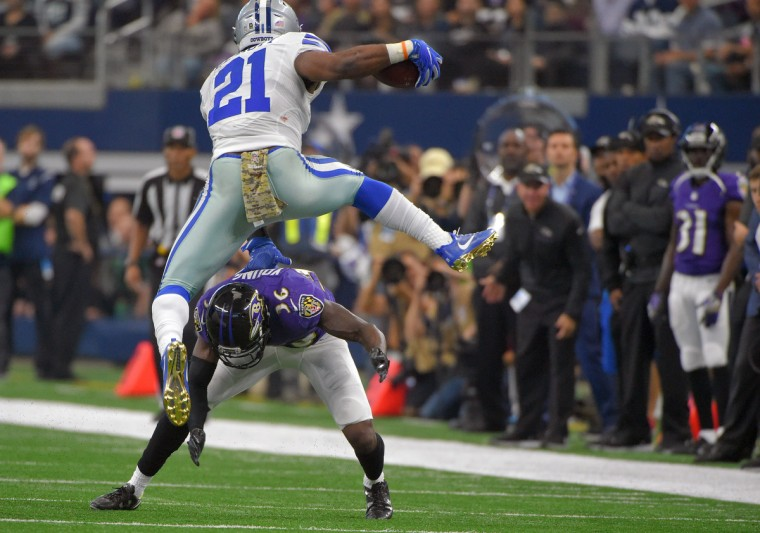Dallas Cowboys running back Ezekiel Elliott (21) leaps over Baltimore Ravens cornerback Tavon Young, who fails to stick into him during the third quarter. Baltimore lost to Dallas, 27-17. (Karl Merton Ferron / Baltimore Sun)