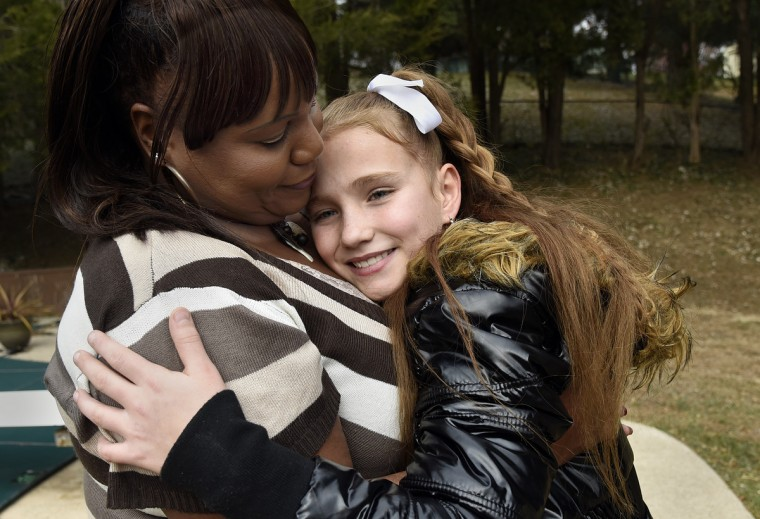 Darlene Legrand and her adopted daughter Bell, 10, celebrate their first official holiday as mother and daughter. (Barbara Haddock Taylor/Baltimore Sun)