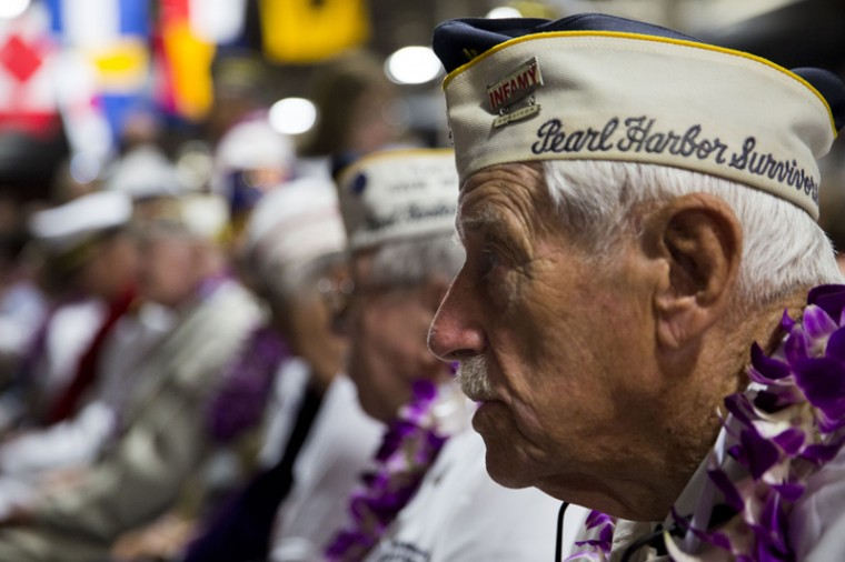Pearl Harbor survivor Dalton Walling sits with other survivors at Kilo Pier in Honolulu before the start of a ceremony commemorating the 75th anniversary of the attack on Pearl Harbor. (Kent Nishimura/Getty Images)