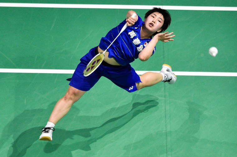 Akane Yamaguchi of Japan plays a shot against Pusarla V Sindhu of India during their women's singles badminton match at the Dubai World Superseries Finals badminton tournament at the Hamdan Sports Complex in Dubai on December 14, 2016. (Stringer/AFP/Getty Images)