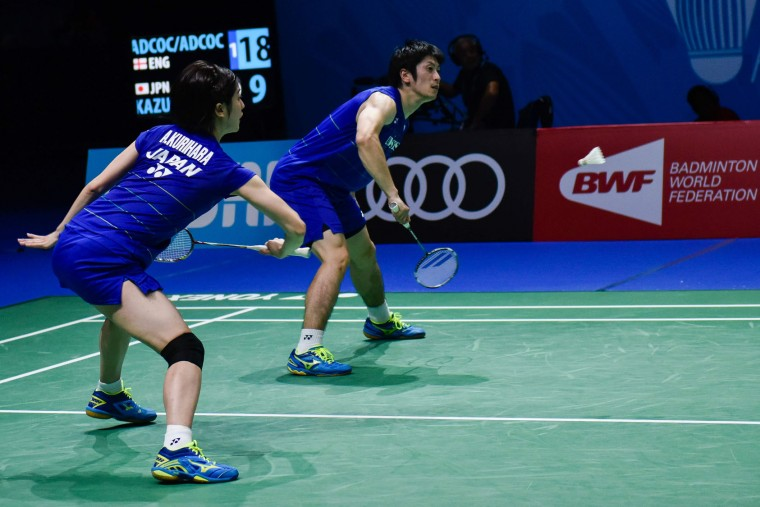 Kenta Kazuno and Ayane Kurihara of Japan compete against Chris Adcock and Gabrielle Adcock of England in the mixed doubles badminton match at the Dubai World Superseries Finals badminton tournament at the Hamdan Sports Complex in Dubai on December 14, 2016. (Stringer/AFP/Getty Images)