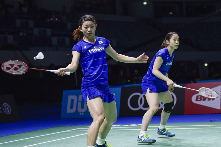 Misaki Matsutomo and Ayaka Takahashi of Japan compete against Naoko Fukuman and Kurumi Yonao of Japan during their women's doubles match at the Dubai World Superseries Finals badminton tournament at the Hamdan Sports Complex in Dubai on December 14, 2016. (Stringer/AFP/Getty Images)