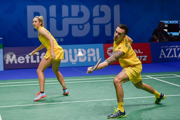 Chris Adcock and Gabrielle Adcock of England compete against Kenta Kazuno and Ayane Kurihara of Japan in the mixed doubles badminton match at the Dubai World Superseries Finals badminton tournament at the Hamdan Sports Complex in Dubai on December 14, 2016. (Stringer/AFP/Getty Images)