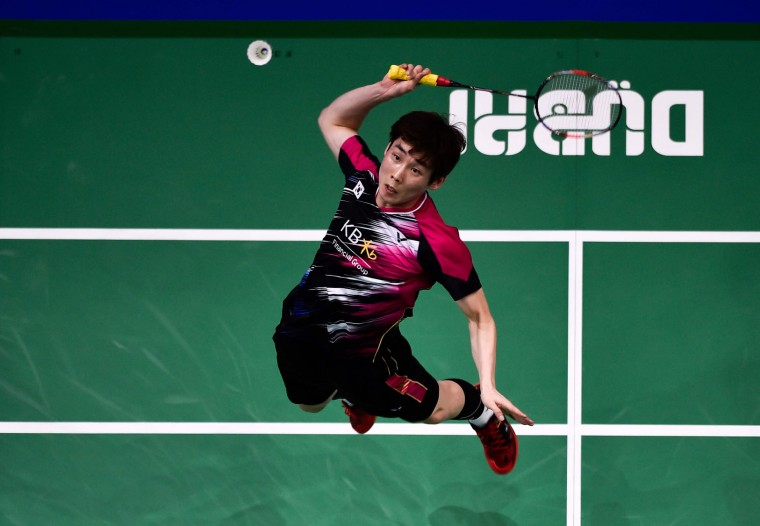 Son Wan ho of South Korea plays a shot against Lee Chong Wei of Malaysia during their men's singles badminston match during the Dubai World Superseries Finals badminton tournament at the Hamdan Sports Complex in Dubai on December 14, 2016. (Stringer/AFP/Getty Images)